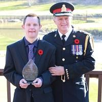 Brad Duncan in uniform with worker